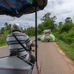 Overloaded Motorbike driving in front of a TukTuk in Siem Reap thumbnail