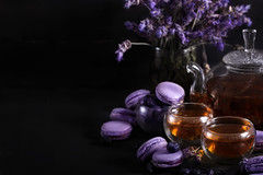 Lavander tea with macarons background (Speleolog) Tags: tea food macarons background dark macaroon france cup sweet vintage french warm style wooden traditional delicious gourmet dessert cream cookie biscuit lighting macaron closeup tasty cuisine pastry black berry blueberry blackberry sour lavender violet purple teapot glass mood still life almond rustic fancy blue berries