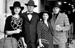 CONTRAST: Two couples waiting to board the Orient Express at London Victoria.... (markwilkins64) Tags: hats blackandwhite bw monochrome mono streetphotography street mark markwilkins glamour orientexpress railwaystation londonvictoria victoriarailwaystation uk london