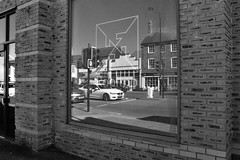 Reflections You Didn't Expect (WorcesterBarry) Tags: blackwhite bnw blackandwhite buildings places travel england street streetphotography streetphoto shadows sky outdoors monochrome lovebw light lines urban humour funny candid reflection architecture traffic cars