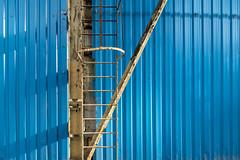 low maintenance (Harm Klaverdijk) Tags: harmklaverdijk breda blue rusty corrugated ladder steelconstruction sun shadow façade industrialdecay
