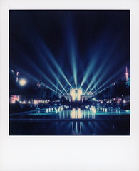 State Fair Nights 2 (tobysx70) Tags: the impossible project tip color sx70 expired instant film sx70sonar sonar roidweek roid week polaroidweek fall autumn october 2018 state fair nights statefairoftexas esplanade fairpark dallas texas tx night nocturnal reflecting pool wet reflection hallofstate topotexastower lights floodlight trees polacon2018 polacon3 polacon 092818 day1 toby hancock photography