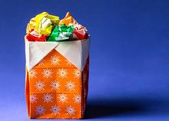 Origami Trash (docoverachiever) Tags: origami macro manmade craft crumple blue orange macromondays folded paper crinkledwrinkledfoldedorcreased challengeyouwinner
