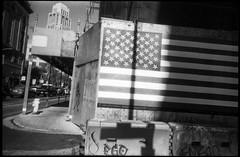 Market St. (icki) Tags: marketst october2018 americanflag blackandwhite flag nopeople sanfrancisco downtown