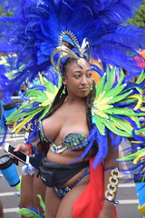 DSC_8430 Notting Hill Caribbean Carnival London Exotic Colourful Blue and Green Costume with Ostrich Feather Headdress Girls Dancing Showgirl Performers Aug 27 2018 Stunning Ladies Décolleté Low Neckline Beautiful Breasts Cleavage (photographer695) Tags: notting hill caribbean carnival london exotic colourful costume girls dancing showgirl performers aug 27 2018 stunning ladies blue green with ostrich feather headdress décolleté low neckline beautiful breasts cleavage
