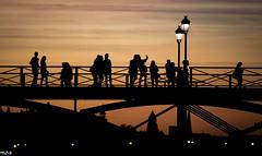 Life of the shadow (Marco Dioguardi) Tags: tramonto orange 250mm canon ponte bridge street people sagoma ombra sunset shadow