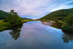 ingonish river (Port View) Tags: fujixe3 ingonishharbour novascotia canada cans2s 2018 summer river water calm reflection evening trees hills sky clouds color colour tide tidal laowa9mm