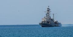 Greek Naval Vessel Sails into Harbour (Myrina Town - Limnos - Greece) (Olympus OM-D EM1-II & M.Zuiko 40-150mm f2.8 Telephoto Zoom) (1 of 1) (markdbaynham) Tags: greece greek grecia greka limnos lemnos em1 hellas hellenic myrina mypina myrinatown olympus omd olympusomd olympusgreece olympusmft olympusem1 em1mk2 em1ii em1mark2 csc evil m43 micro43 microfourthird microfourthirds mft mzd mz zd mzuiko zuikolic 40150mm olympusprolens prozoom telephoto m43rd travel micro43rd town northaegean northaegeanisland aegeanisland naval