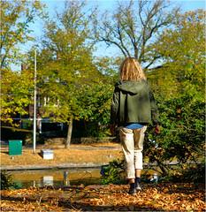 Autumn Leaves (Hindrik S) Tags: autumn fall hjerst herbst herfst leaves bladeren blêden blätter neijier najaar girl frou famke mädchen meisje woman back rêch rücke rug color colour kleur farbe oktober october walking sonyphotographing sony sonyalpha α77 slta77ii sonyilca77m2 sal1650 sony1650mmf28dtssm 2018 streetphoto strjitfotografy streetphotography street straat strjitte strasse prinsetún prinsentuin liwwadden ljouwert water wasser wetter park garden tún tuin garten