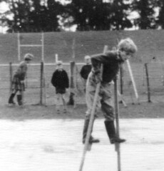 Stils play has to be done wearing wellingtons (theirhistory) Tags: boy children kids girls school class form group pupils jumper trousers jacket wellies grass playground dress skirt rubberboots