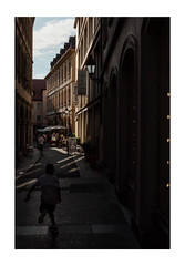 Adventure in the Shade (Thomas Listl) Tags: thomaslistl color würzburg contrast lightandshadow sunlight facade architecture alley child play street 35mm dailylife atmosphere mood warm summer ngc