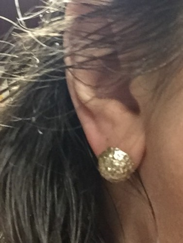 wearing earring - faux silver earrings
