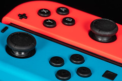 Perfect Match (jeff's pixels) Tags: perfectmatch macromondays nintendo switch controller gamepad blue red color macro nikon d850 button thumbstick