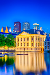 The Famous Binnenhof Palace of Parliament in The Hague in The Netherlands at Blue Hour.Skyscrapers Skyline On The Background. (DmitryMorgan) Tags: binnenhof gollandia gollandiya haag hague holland netherlands architecture bluehour buildings denhaag dusk dutch europe evening fountain government governmental historic hofvijver hollander kingdomofthenetherlands lights mauritshuis newplaces night places pond reflections skies skyline skyscrapers specific towers travellingconcept unique water
