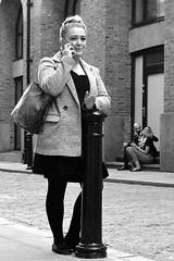 """My way or the highway""..... (markwilkins64) Tags: animated uk london southbank grainy noise markwilkins couple road streetportrait portrait mono bw blackandwhite candid streetphotography street"