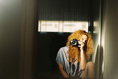 (aclaudine) Tags: 35mm film colors portrait selfportrait woman curls naturallight mirror home canon 50mm analog indoors