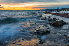 Sunset at the Breakwater (markmorgen) Tags: harbor lighthouse sunset