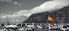 Los Gigantes (endresárvári) Tags: tenerife gigantes losgigantes rock port harbor haven spanishflag flag bw selectedcolor monochrome spain canaryislands ocean cloud clouds