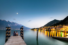 Silence (Zscherny) Tags: lake see wasser water blue long tlme time exposure pier lago gardasee limone moon city lights nature landscapephotography landscape night nikon man woman