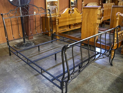 Queen size iron bed ($224)