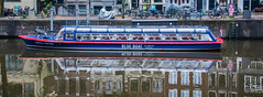 2018 - Amsterdam - Blue Boat Company (Ted's photos - For Me & You) Tags: 2018 amsterdam cropped nikon nikond750 nikonfx tedmcgrath tedsphotos vignetting blueboatcompany blueboatcompanyamsterdam boat bikes bicycles reflection waterreflection blueboat widescreen wideangle