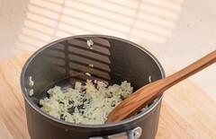 Rissotto with onion. (annick vanderschelden) Tags: cook rice hot prepared spatula wood pan handle black food italian consistency belgium