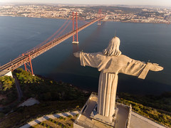 Luftaufnahme von hinten Cristo Rei Statue und Ponte 25 de Abril Brücke in Almada Lissabon (verchmarco) Tags: locationindependent dnx lisbon aerialaesthetics luftbildaufnahme aerial portugal dji lisboa reiseblogger luftaufnahme digitalnomad reisen travel lissabon mavicair aerialphotography noperson keineperson water wasser reise bridge brücke architecture diearchitektur sky himmel outdoors drausen city stadt transportationsystem transportsystem river fluss vehicle fahrzeug suspensionbridge hängebrücke dam damm landscape landschaft harbor hafen lake see seashore strand sea meer watercraft wasserfahrzeug ship schiff pentax kodak tower transport harbour rose waterfall fountain children