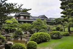 Ito Denemon Residence in Izuka City, Fukuoka Prefecture, Japan (Beltoiner) Tags: denemonito coalmining trees wood ancient green fukuoka japan japanesegarden house traditional