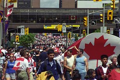 Canada Day in Ottawa (pmvarsa) Tags: summer 2001 july analog film 135 kodak kodakgold 400iso nikonsupercoolscan9000ed nikon coolscan cans2s national holiday crowd celebration street building flag patriotism patriotic patriot people traffic lights party canon ftb canonftb classic camera ottawa ontario canada