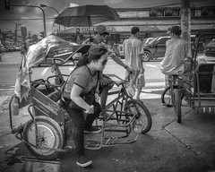 Arrived Safely (Beegee49) Tags: street pedicab transport public tricycle driver passenger woman man black white monochrome bw bacolod city philippines asia shopping waiting happy planet happyplanet asiafavorites