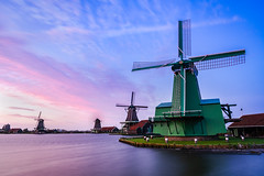 Standing in the Wind (Trent's Pics) Tags: zaanseschans amsterdam clouds dutch holland landscape netherlands storm water wind windmill windmills windy