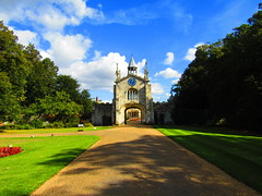 The Entrance To Bishopthorpe Palace York. (Gary Chatterton 4 million Views) Tags: bishopthorpepalace bishopthorpe archbishopofyork york northyorkshire roadway grass trees entrance gateway clock nature colours yorkshirecameraramblers flickr explore photography canonpowershot