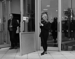 Phone Envy (Bury Gardener) Tags: burystedmunds bw blackandwhite england eastanglia uk britain 2018 snaps suffolk streetphotography street streetcandids candid candids people peoplewatching folks arc thearc