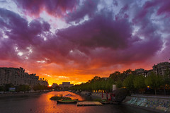 Sunset in Bucharest (Adrian Mitu) Tags: sun sunset water reflection goldenhour pink orange sly clouds outdoors cityscape river bucharest romania