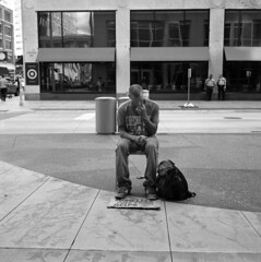 untitled (kaumpphoto) Tags: rolleiflex 120 tlr bw black white street urban city minneapolis homeless man sit sidewalk backpack sign lines police center reflection