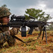 Marines train with a M249 Light Machine Gun at a target during a fire and movement range at Camp Hansen