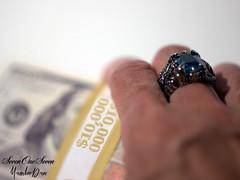 Go on, take the money and run (SevenOneSeven MamboDan) Tags: goontakethemoneyandrun stillphotography closeup ring hand money 10000dollars