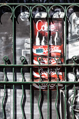Caffeine capture (A Different Perspective) Tags: australia fremantle perth westernaustralia cocacola coke flower gate green poster red shadow wall