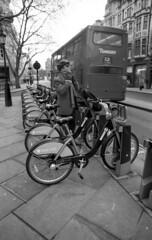 London (Manuel Goncalves) Tags: bike road people london england nikonn90s 35mmfilm blackandwhite ilfordfp4plus125 sigma24mmlens epsonv500scanner