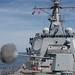 USS Jason Dunham (DDG 109) fires its M45 5-inch gun.
