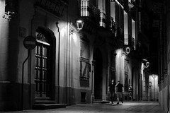 Night life (Daniel Nebreda Lucea) Tags: night noche city ciudad noir light luces luz monochrome monocromatico monocromo fear miedo walking andando people gente life vida street calle alley callejon calleja old viejo antiguo urban urbano architecture arquitectura travel viajar black white blanco negro door puerta casco hisoric historico tubo zaragoza europe europa scene escena friend friends amigos shadows sombras textures texturas farolas atmosphere amosfera mood long exposure larga exposicion moon luna perspective perspectiva composition composicion canon 60d 50mm dark darkness oscuro