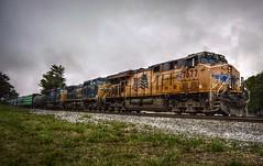 Foreign power (builder24car) Tags: railfanning benchingthefreights locomotives manifesttrain rain clouds foreignpower unionpacific up7677 csx7749 ltex8762 thomasvillenorthcarolina