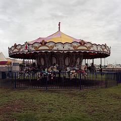 Merry-go-round (Eddie La Mole) Tags: carousel carrusel merrygoround roundabout oldsanjuan bahíaurbana film 120 c41 portra160 hasselblad500cm distagon50 lasamaritana usetheforce seatofthepantsmeteringtechnology