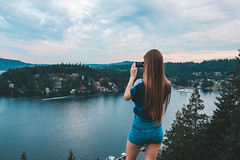 Capture the moment (Top KM) Tags: canada british columbia vancouver travel one person woman female north exploring people hike hiking sky sunset sundown outdoors outdoor outside making photo young clouds taking phone on cloudscape water waterfront cloudy
