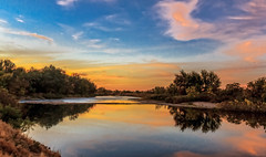 A Sunset Over The Payette River (http://fineartamerica.com/profiles/robert-bales.ht) Tags: freshwater gemcounty haybales idaho people photo places states sunsetorsunrise sunrise sunset emmett treasurevalley fall payetteriverreflections river scenic water scenicbiway blue americaphotography northamericaphotography pacificnorthwestphotography idahophotography beautiful sensational spectacular scenicriverphotography riverphotography panoramic awesome magnificent peaceful surreal sublime magical canonshooter red clouds robertbales snakeriver yellow trees