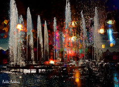 Glowing Fountain (brillianthues) Tags: fountain lights night reflection glow longwood gardens colorful collage photography photmanuplation photoshop