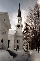 50-126 (ndpa / s. lundeen, archivist) Tags: nick dewolf nickdewolf color photographbynickdewolf 1973 1970s film 35mm 50 reel50 winter maine centralmaine snow snowy snowfall newengland ontheroad roadtrip sky clouds building buildings trees branches house home church steeple tower steps stairs sidewalk snowbank doverfoxcroft congregationalchurch doverfoxcroftcongregational trip vacation wintertrip wintervacation