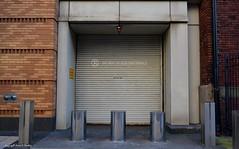 (Little Hand Images) Tags: donotblockentrance garage door cylinders blocked sidewalk street building washingtondc noparking