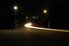 Light trail on the Sir George-Étienne Cartier Parkway (Pwern2) Tags: ottawa ottawaregion ncr nationalcapitalcommission ncc nationalcapitalregion light lighttrail cars rockliffe street rockliffelookout concrete streetlamps carlights carheadlights longexposure highaperture road car blur night headlights sirgeorgeétiennecartierparkway