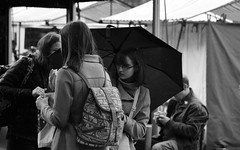 Rain Shower (Bury Gardener) Tags: bw blackandwhite monochrome mono nikond7200 nikon england eastanglia uk ely streetphotography street streetcandids snaps candid candids people peoplewatching folks 2018 market streetmarket